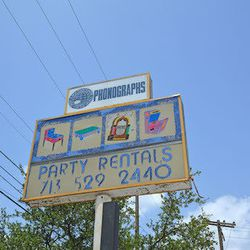 Sign from former business on the property.