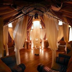 Allyu Spa (600 West Chicago Avenue, 312-755-1313) is an earthy, spiritual-feeling spa right on the Chicago River. Built with sustainable materials including reclaimed barn wood and mesquite, the spa has a candle-lit relaxation area (pictured) at its cente