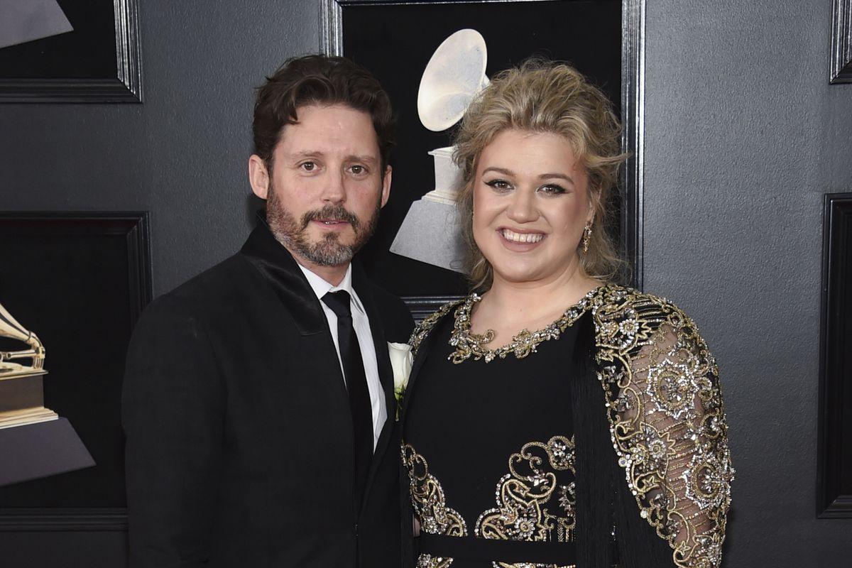Kelly Clarkson and her husband Brandon Blackstock arrive at the 60th annual Grammy Awards in New York in 2018.