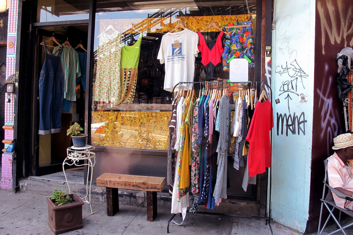 Bookkeepers storefront, with racks of vintage clothes and graffiti