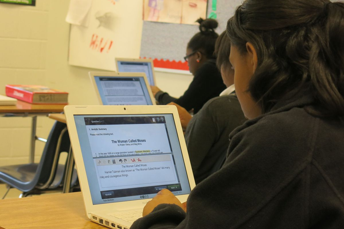 Colonial Middle School eighth graders practice taking the writing assessment online.