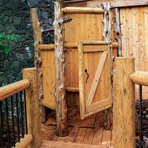 <p><strong>Unobstructed Views</strong><br>Stripped of their bark, eastern red cedar trunks are used as the posts for the enclosure of this shower in central Virginia. The white pine door and<br> walls are elevated off the ground to promote airflow at the bottom, and stop at about 5 feet at the top so the homeowners can take in views of the surrounding Blue Ridge Mountains.</p>
