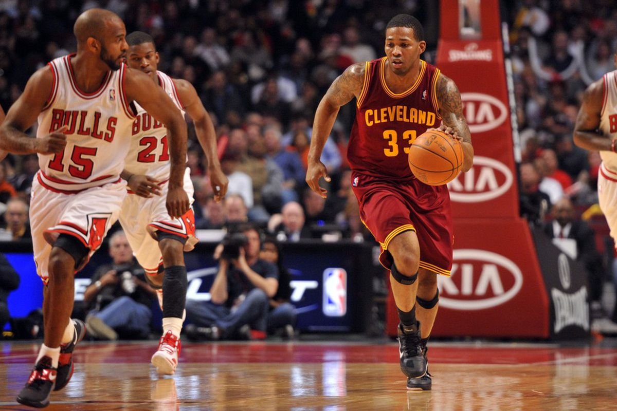 April 26, 2012; Chicago, IL, USA; Cleveland Cavaliers small forward Alonzo Gee (33) dribbles against the Chicago Bulls during the second half at the United Center. The Bulls beat the Cavaliers 107-75.  Mandatory Credit: Rob Grabowski-US PRESSWIRE