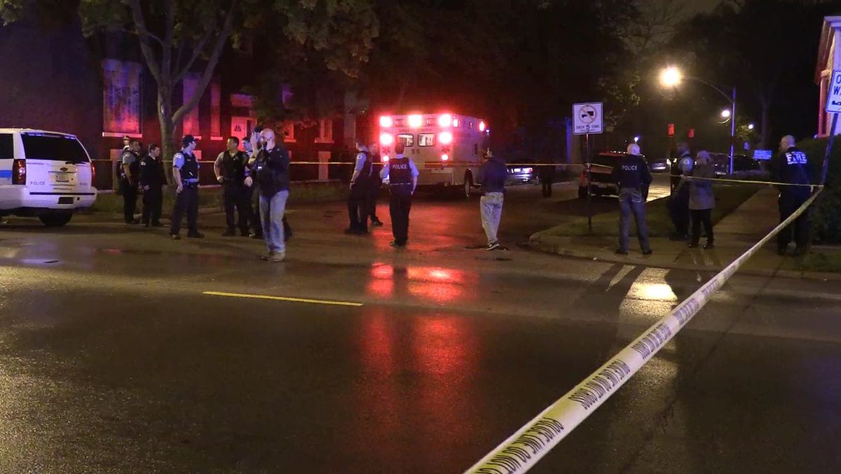 Police investigate after two people were killed and a third was critically wounded in a shooting Wednesday night in Englewood. | Network Video Productions