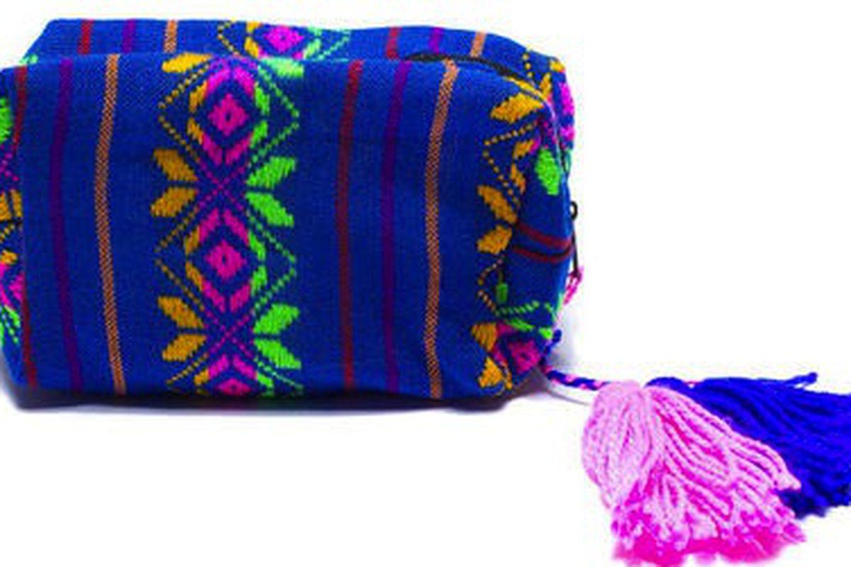 "Blue Cambaya Cosmetic Bag, <a href=""http://www.shoptiques.com/products/blue-cambaya-cosmetic-bag-w-pompom"">$39</a> at Babel Fair"