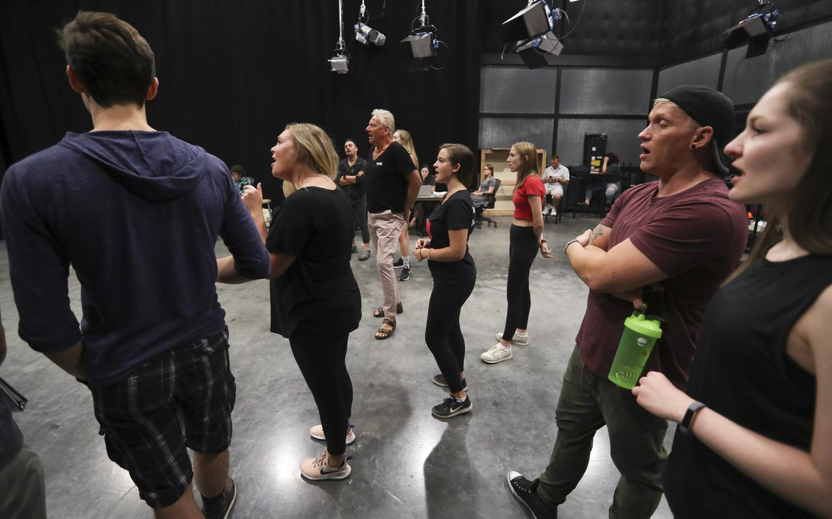 """Air Supply's Graham Russell, center, sings with the cast during rehearsal for the musical """"A Wall Apart"""" at the TV studio on the Salt Lake Community College campus in Salt Lake City on Tuesday, July 30, 2019."""