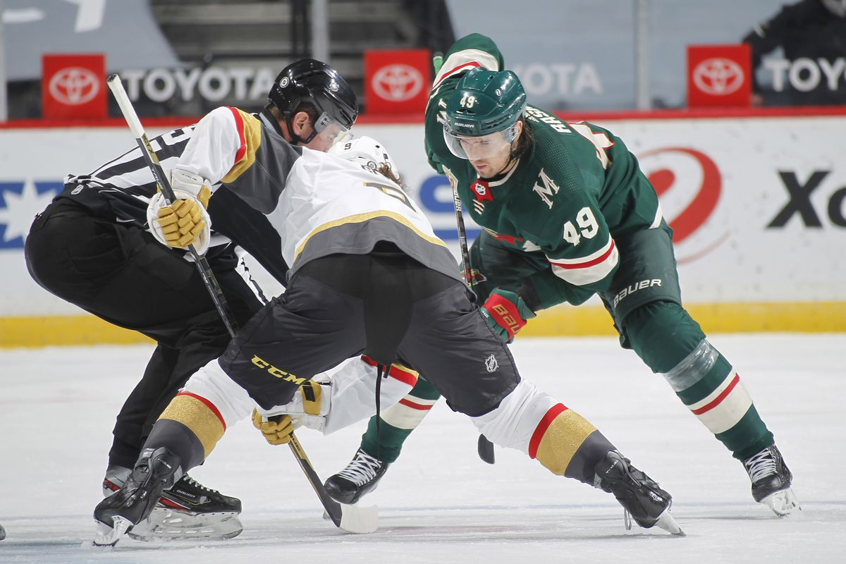 Cody Glass #9 of the Vegas Golden Knights takes a face-off against Victor Rask #49 of the Minnesota Wild during the game at the Xcel Energy Center on March 8, 2021 in Saint Paul, Minnesota.