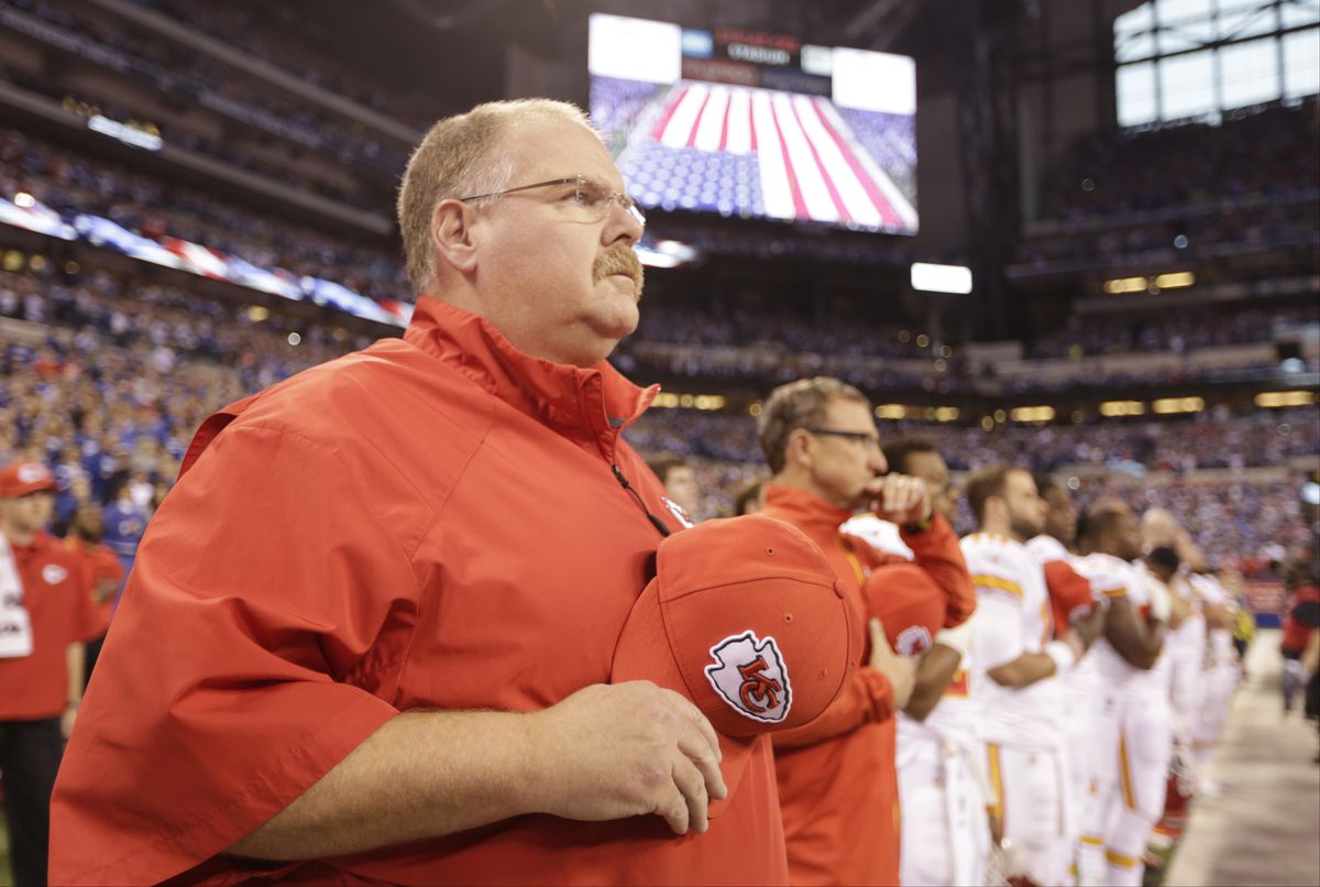 Kansas City Chiefs head coach Andy Reid listens during the National Anthem before an NFL wild-card playoff football game between the Indianapolis Colts and the Kansas City Chiefs Saturday, Jan. 4, 2014, in Indianapolis.