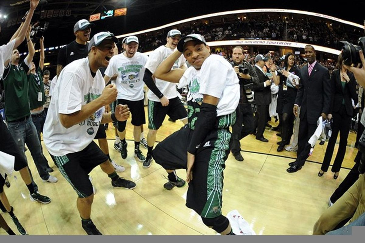 March 10, 2012; Cleveland, OH, USA: Ohio Bobcats guard Stevie Taylor (center) with his teammates after defeating the Akron Zips 64-63 in the finals of the 2012 MAC Tournament at Quicken Loans Arena.  Mandatory Credit: Eric P. Mull-USPRESSWIRE