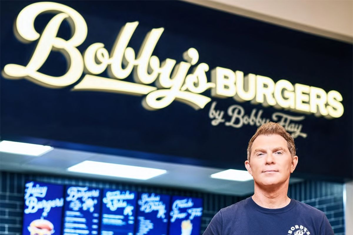 Celebrity chef Bobby Flay stands in front of his Bobby's Burger outpost at Caesars Palace.
