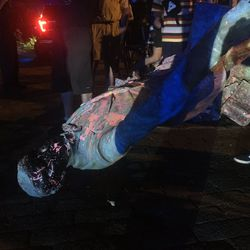 The statue of Confederate President Jefferson Davis is splattered with paint after it was toppled Wednesday night, June 10, 2020, along Monument Drive in Richmond, Va.
