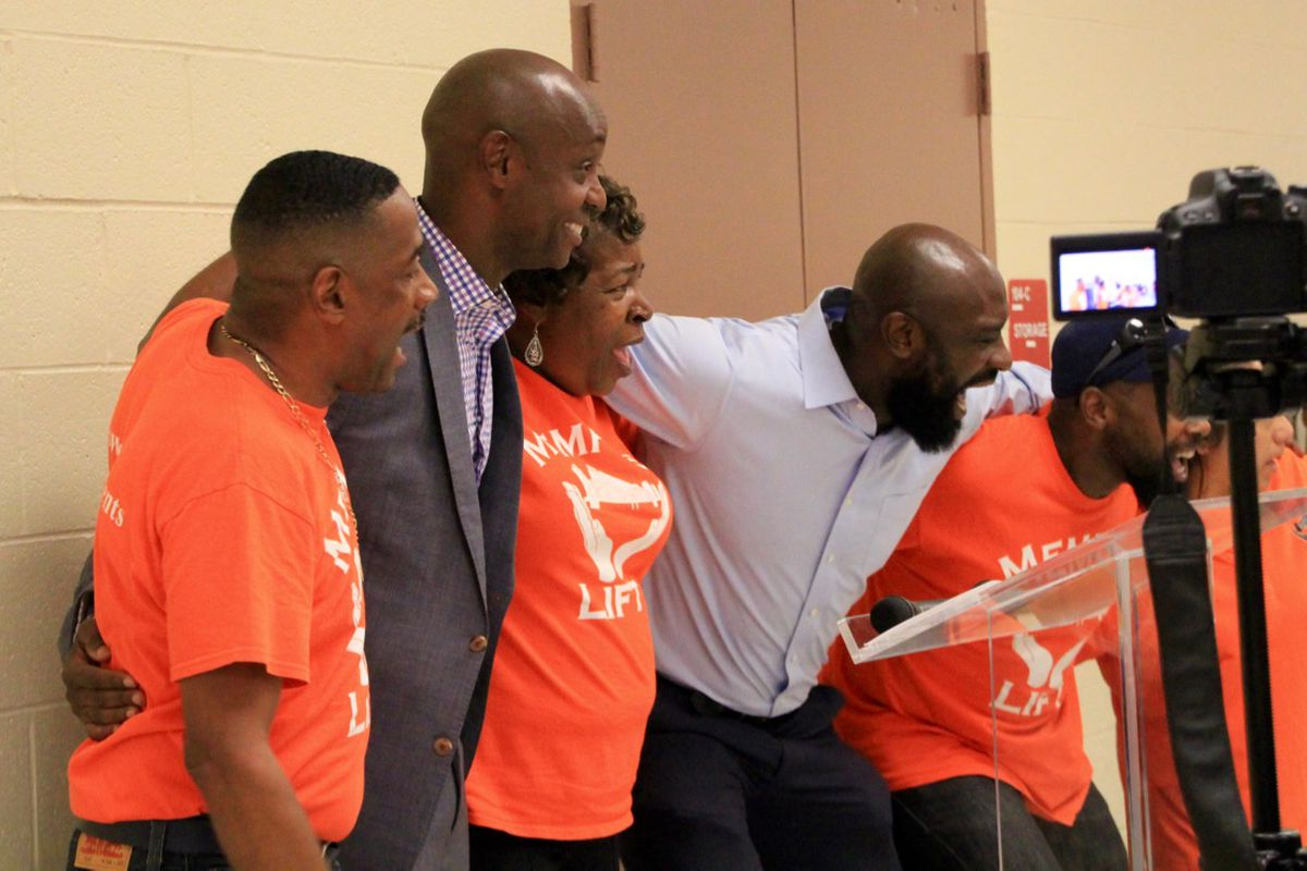 """Leaders of Memphis Lift take literally Superintendent Dorsey Hopson's call to """"lock arms and work together"""" following Hopson's presentation to the parent advocacy group in July 2017."""