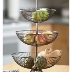 """""""Don't hide your farmer's market finds! Keep those ripened beauties on the counter, where everyone can admire them. We like this vintage-inspired wire basket, but any large bowl will do."""" <br> <i><a href=""""http://www.wayfair.com/St.-Croix-Kindwer-Three-T"""