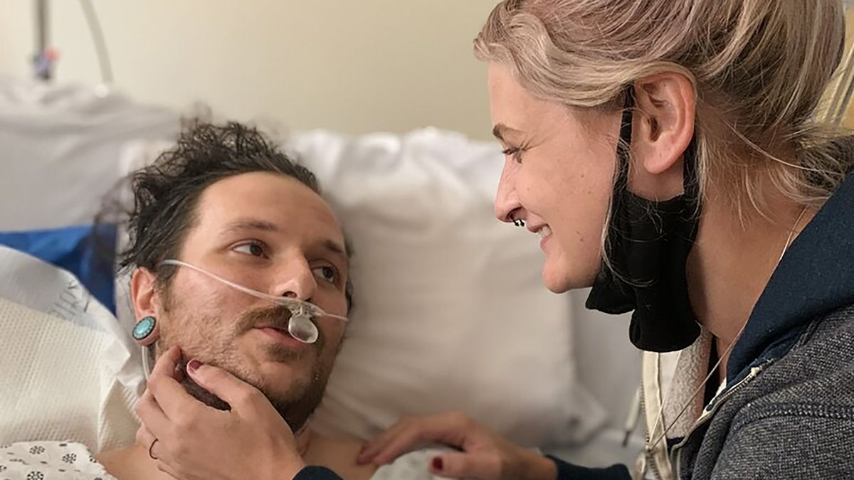 Sam Metcalfe with his partner Sabrina Parziale recovering from his gunshot wounds
