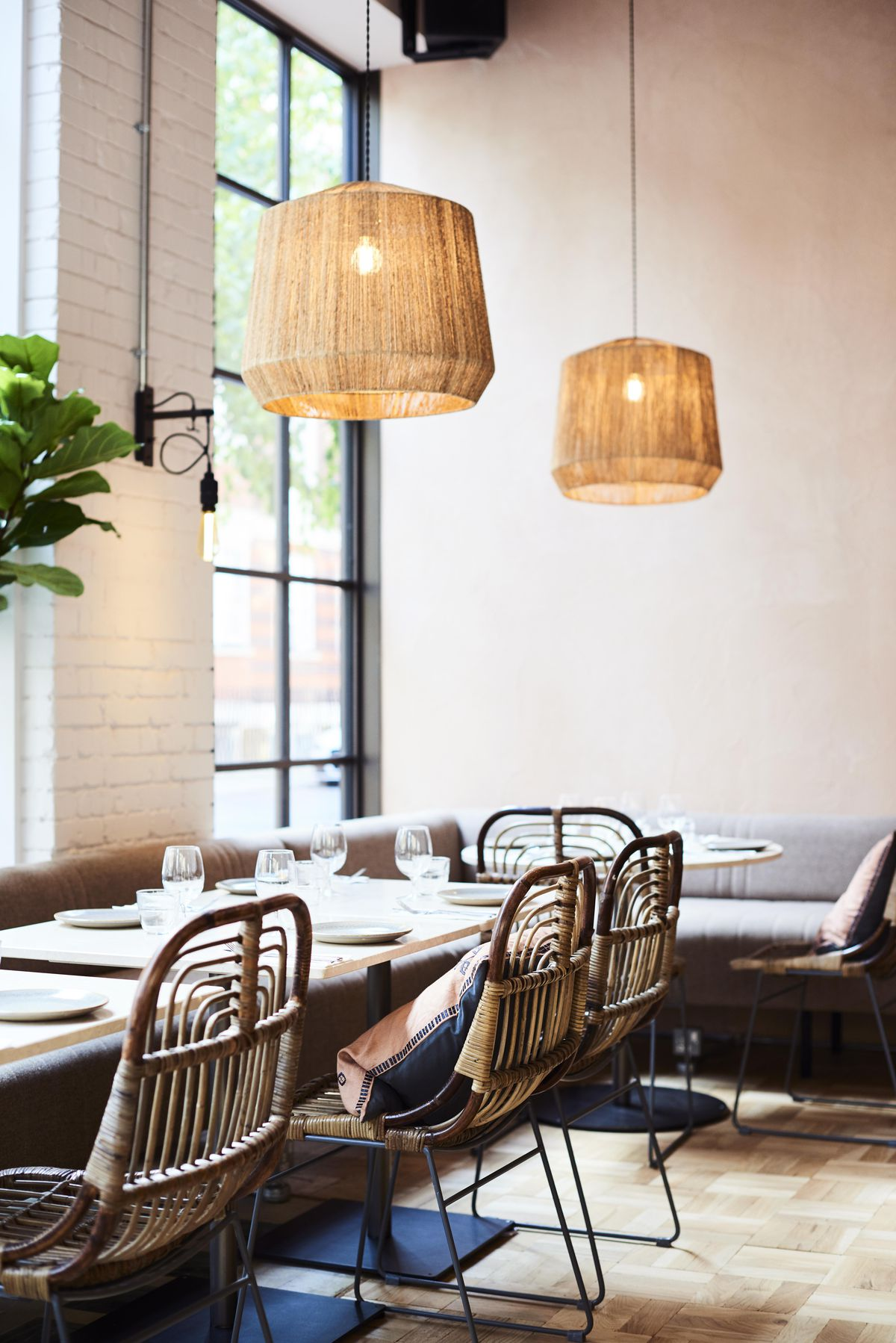 Lampshades, table settings and sofas at Caravan Coffee Roasters' new site in Fitzrovia, London