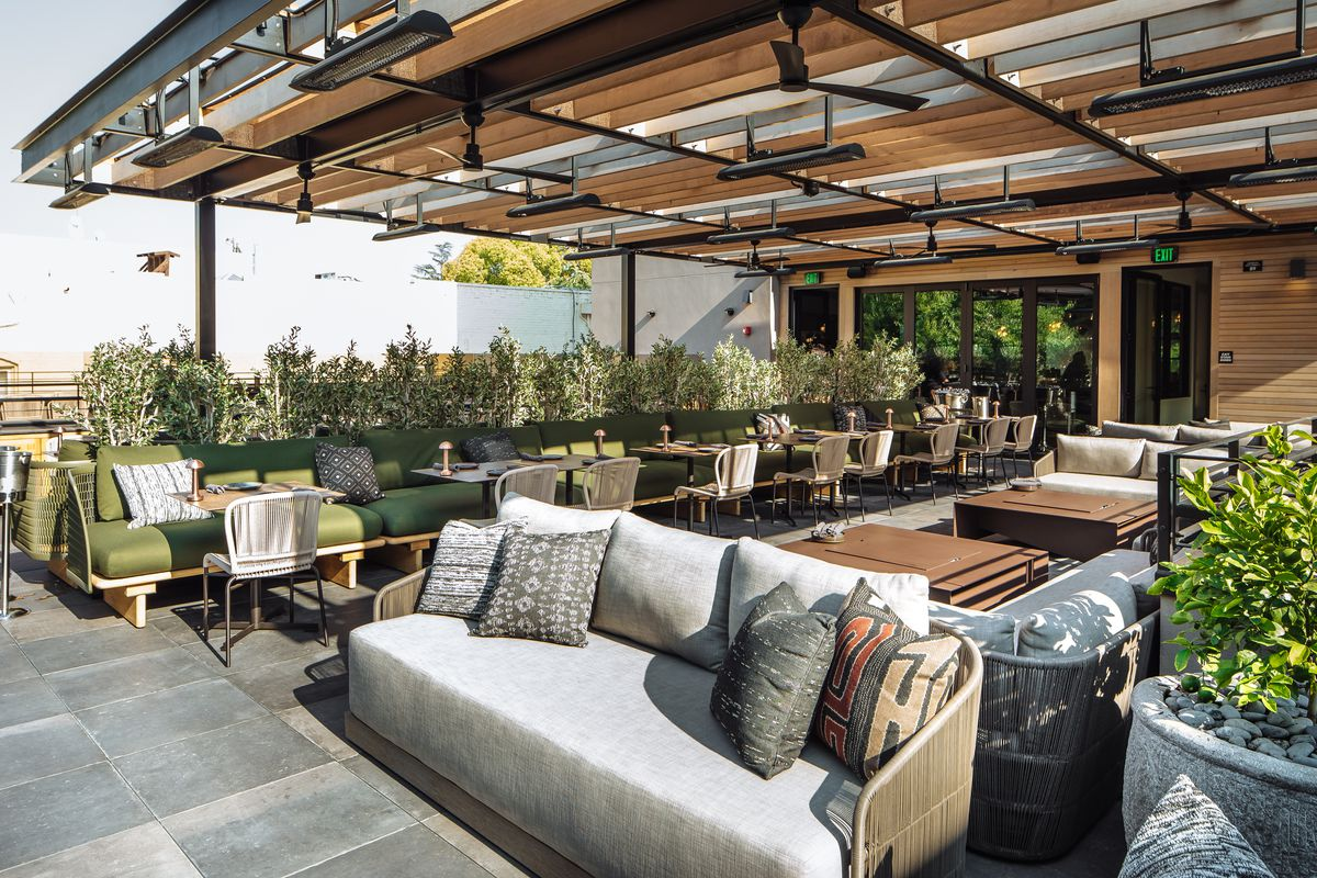 Roof 106, a rooftop bar and lounge with greenery and couches, at the Matheson