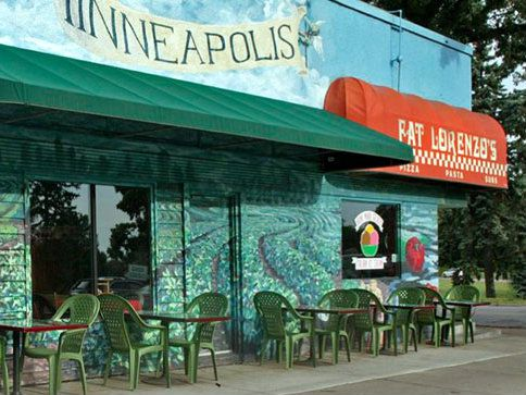 The exterior with a green and blue mural of Minneapolis greenery and water