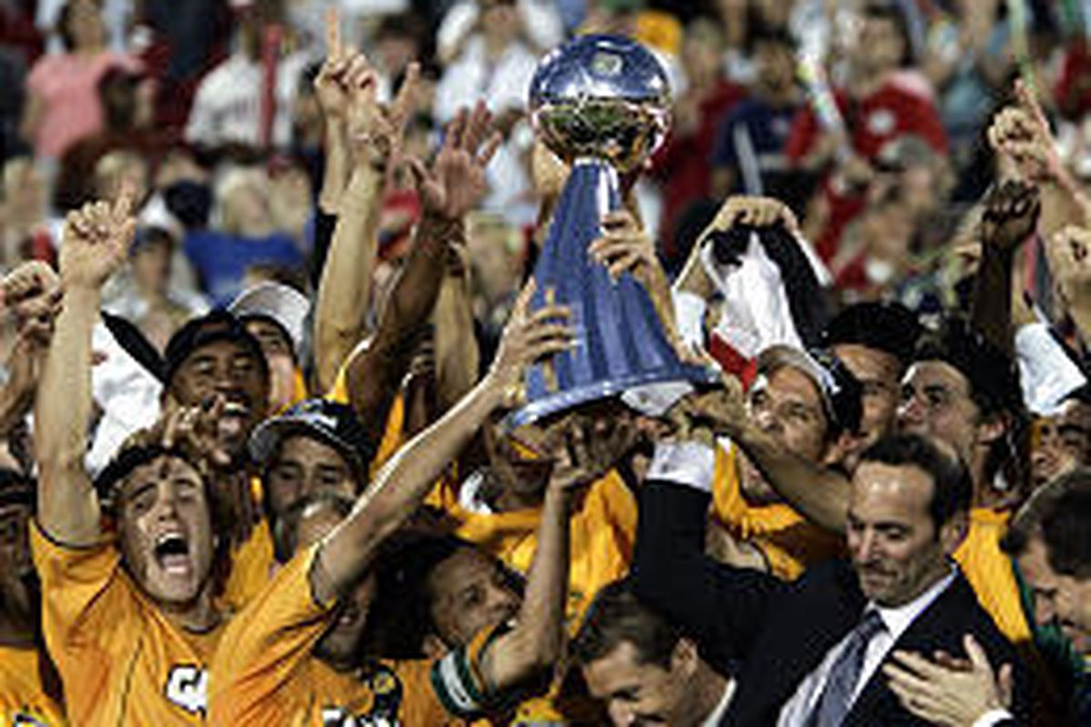 Los Angeles Galaxy team members celebrate the MLS championship after beating New England, 1-0, Sunday in Frisco, Texas.