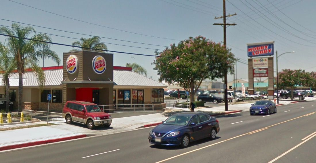 A Burger King restaurant fronted by a busy street
