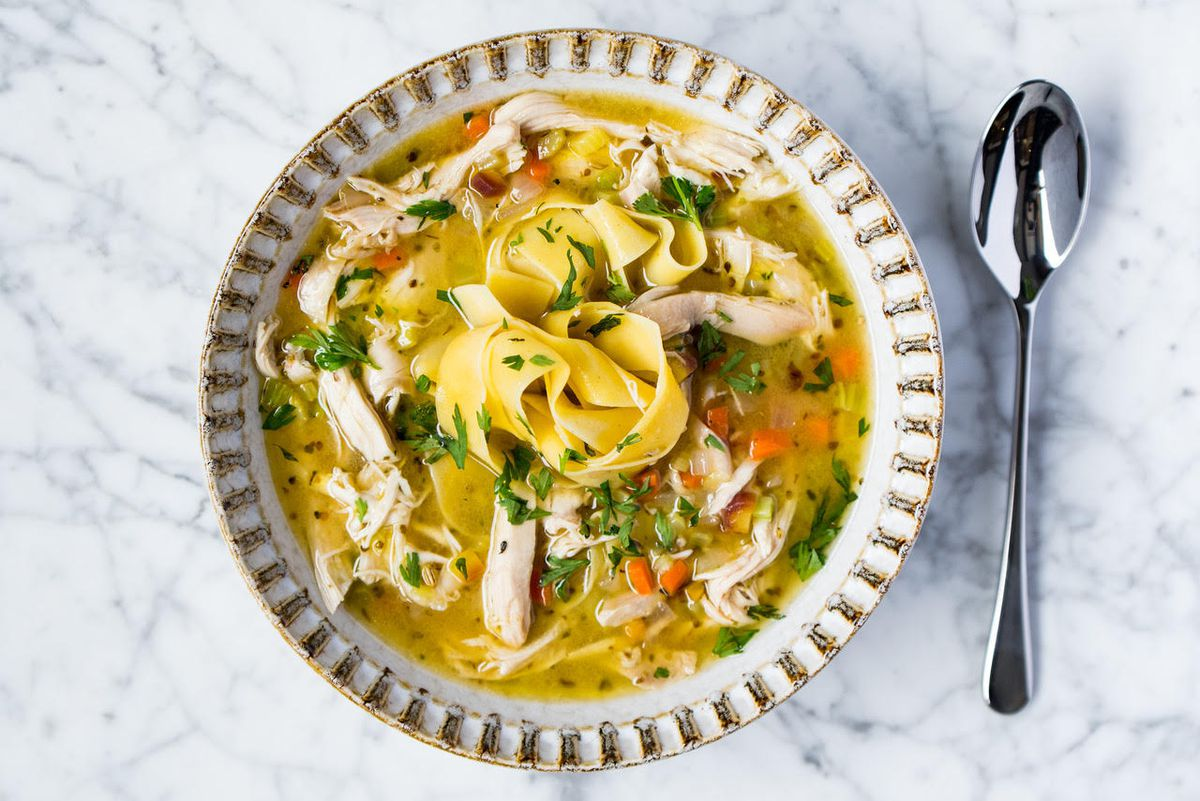 A bowl of chicken noodle soup