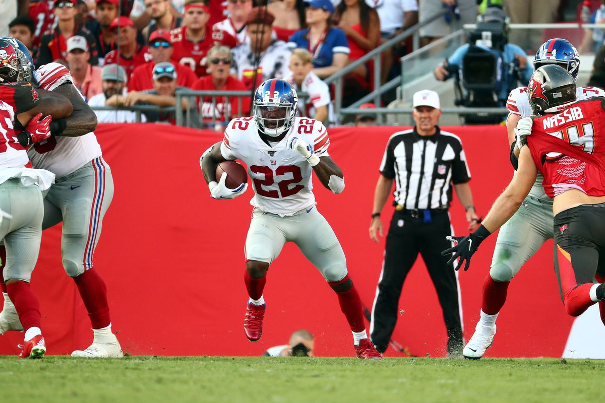 New York Giants running back Wayne Gallman runs with the ball against the Tampa Bay Buccaneers during the second half at Raymond James Stadium.