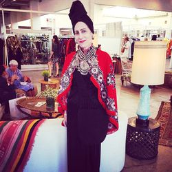 """Tova Kaye of <a href=""""http://www.owlvintage.etsy.com"""">Owl Vintage</a> wearing an amazing cape and headwrap combo."""