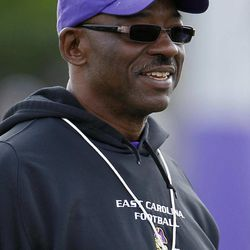 In this Wednesday, April 11, 2012 photo,  East Carolina coach Ruffin McNeill watches during football practice in Greenville, N.C. With Dominique Davis gone, East Carolina has an open race for its starting quarterback job.
