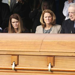 Myron Walker sits near the casket of his wife, former Utah Gov. Olene Walker, during a graveside service at the Salt Lake City Cemetery in Salt Lake City on Friday, Dec. 4, 2015. Walker died of natural causes at age 85.