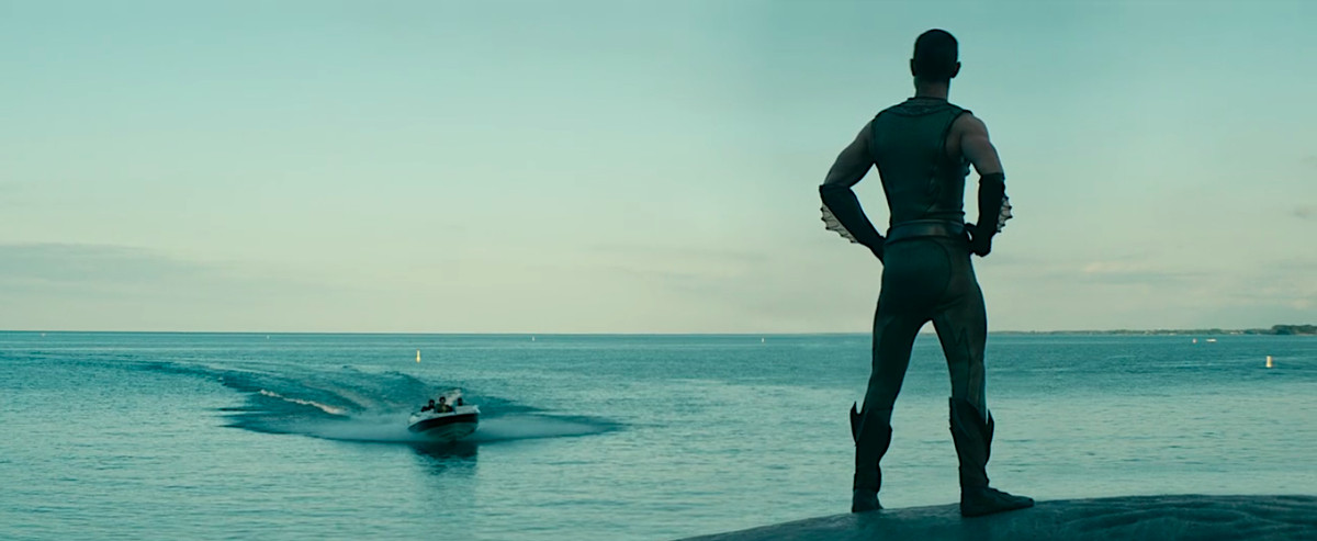 Chace Crawford stands atop a whale, looking out over the water, in season 2 of The Boys