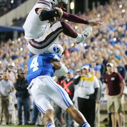 Mississippi State Bulldogs quarterback Nick Fitzgerald (7) flips into the air after being hit by BYU Cougars linebacker Fred Warner (4) as he scores a touchdown in OT as BYU and Mississippi State play in Provo at LaVell Edwards Stadium on Friday, Oct. 14, 2016.