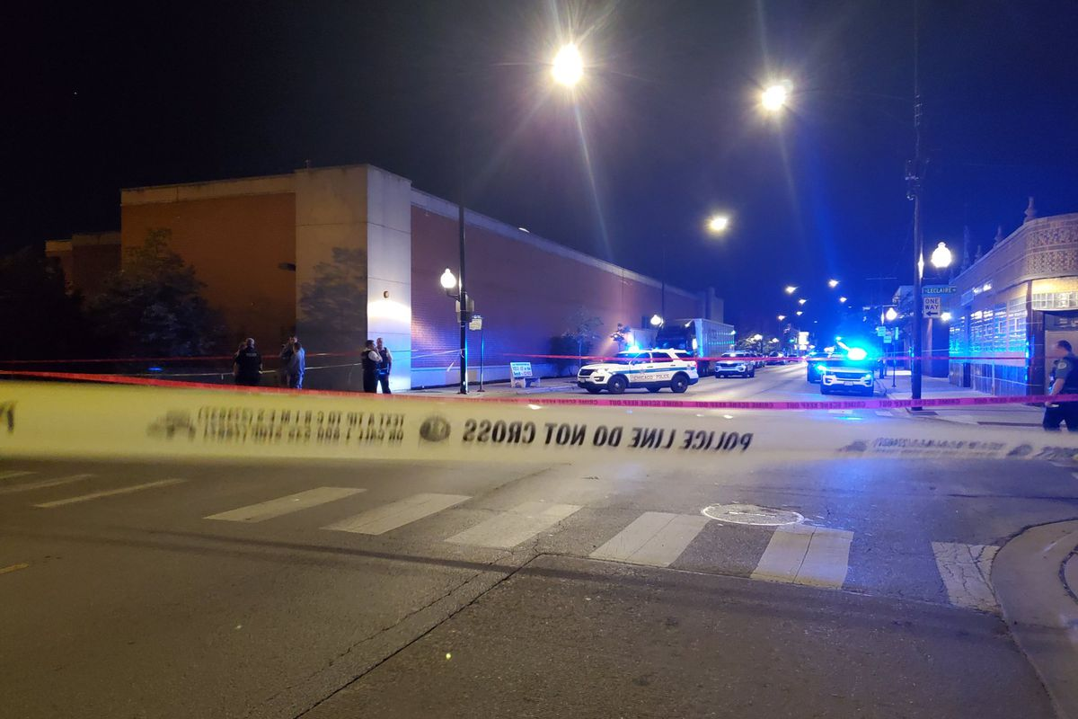 Chicago police investigate the scene September 13, 2019 where a 46-year-old man was killed in a drive-by in Cragin on the North Side.