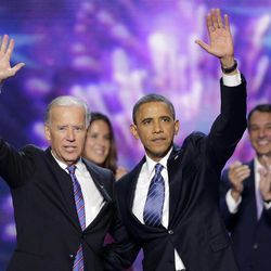 Vice President Joe Biden and President Barack Obama wave to the delegates at the conclusion of Presdident Obama's speech at the Democratic National Convention in Charlotte, N.C., on Thursday, Sept. 6, 2012.