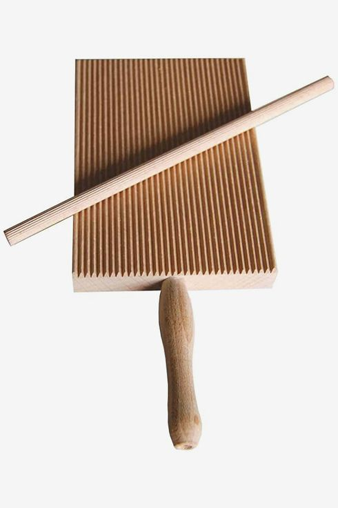 A wooden pasta stripper