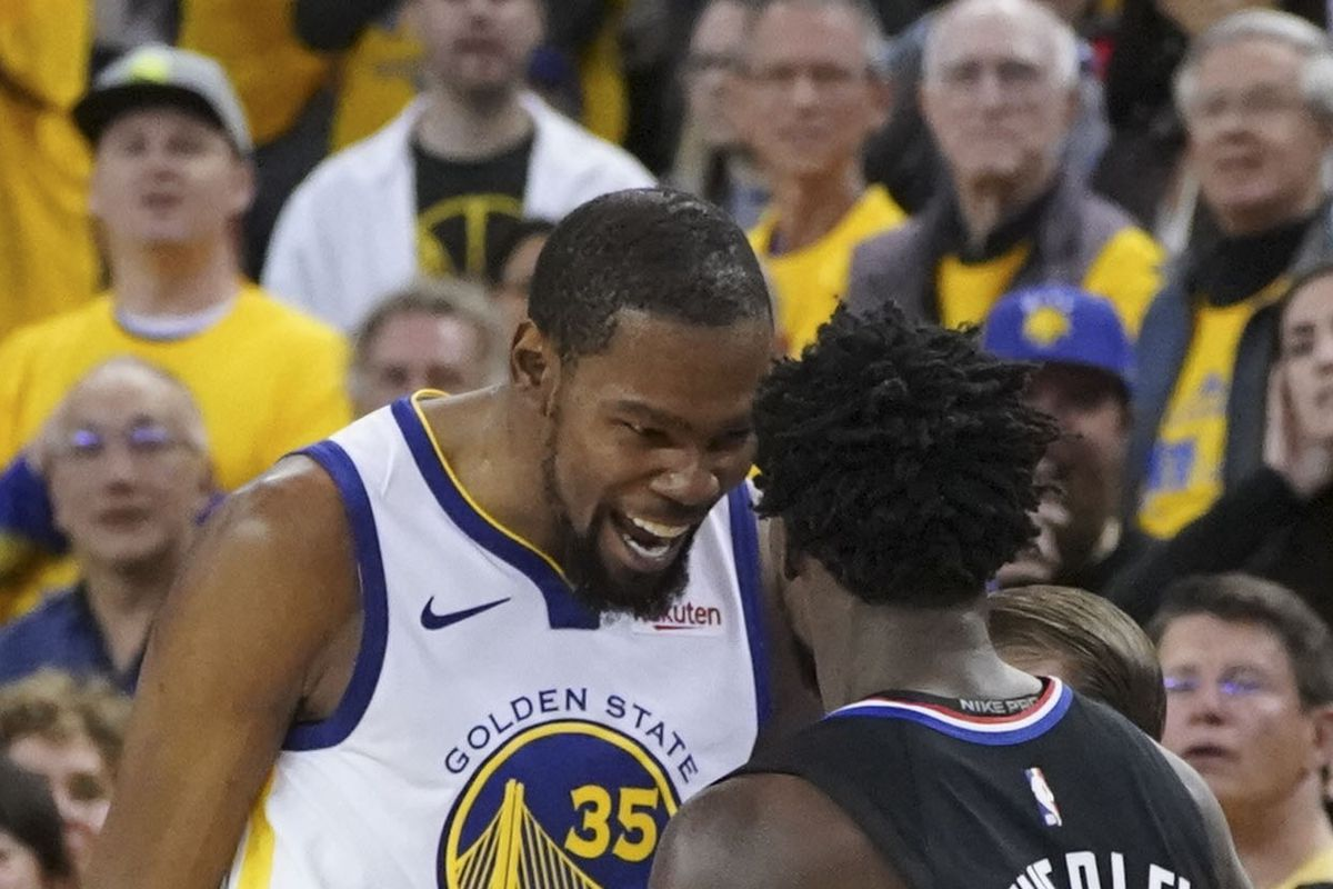 ec11235437e Kevin Durant laughs at Patrick Beverley in game one. Kyle Terada-USA TODAY  Sports