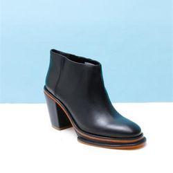 """<a href=""""http://shop.creaturesofcomfort.us/rachel-comey-bout-platform-boots-black.aspx"""">Bout Platform Boots</a>, $314.30 (was $449)"""
