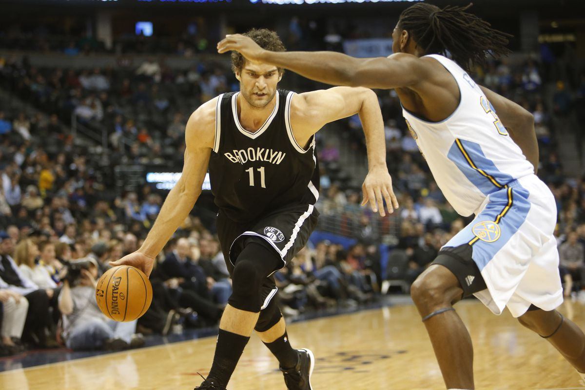 Brook Lopez dribbles into the paint against Kenneth Faried