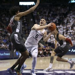 Brigham Young Cougars guard Jake Toolson (5) drives against Santa Clara Broncos guard Jalen Williams (24) at Brigham Young University in Provo on Thursday, Feb. 20, 2020.