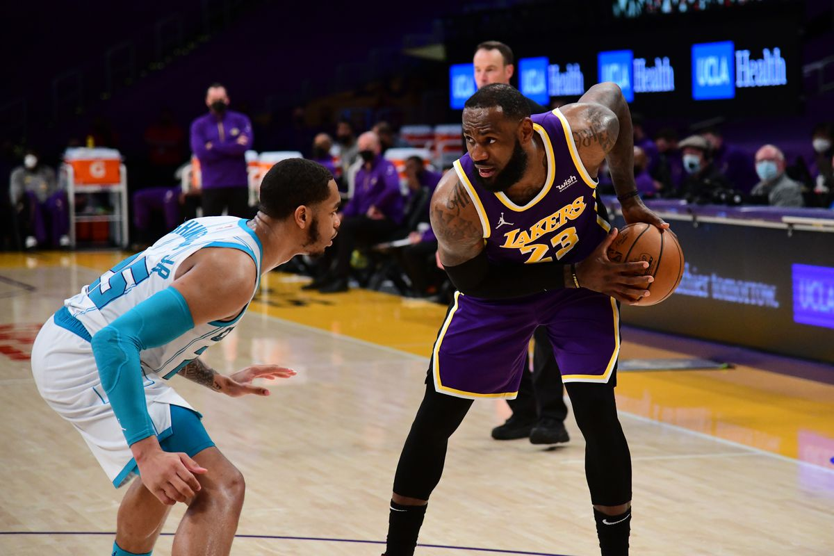 LeBron James of the Los Angeles Lakers handles the ball during the game against the Charlotte Hornets on March 18, 2021 at STAPLES Center in Los Angeles, California.