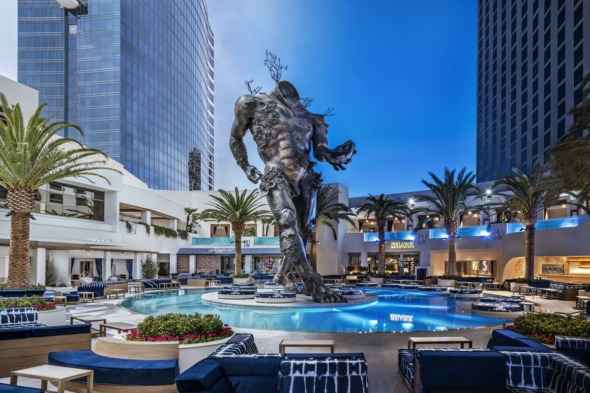"""Damien Hirst's """"Demon with Bowl"""" anchors the new Kaos pool club at the Palms."""