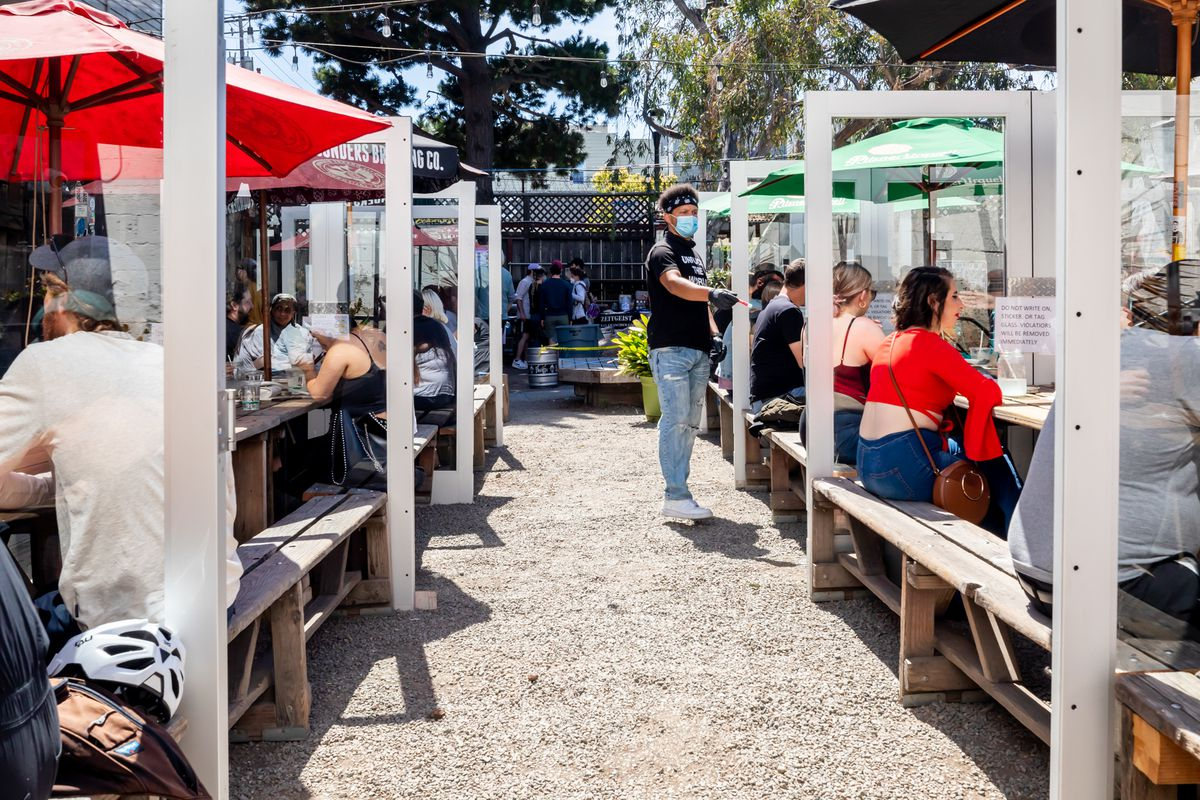 Zeitgeist has turned the picnic tables on its patio into glass booths