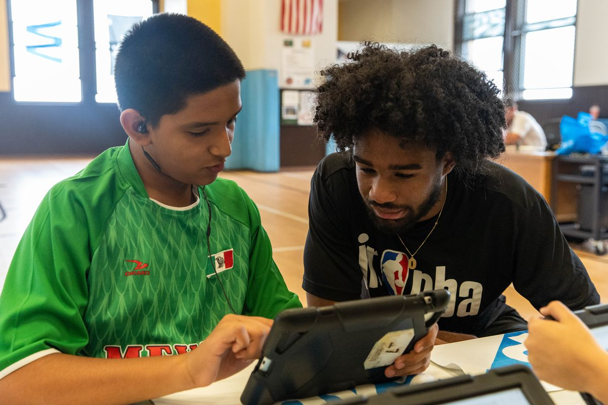 Watch: Bulls rookie Coby White surprises Gary Elementary students