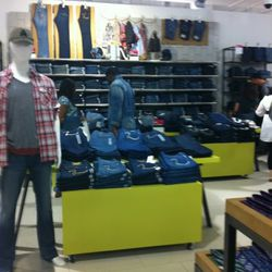 The men's denim section, largely populated with True Religion jeans