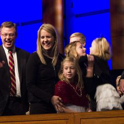 Clark G. Gilbert and his family recognize a familiar face in the crowd. Taken by Erik Hill. Tuesday, Jan. 27, 2015.