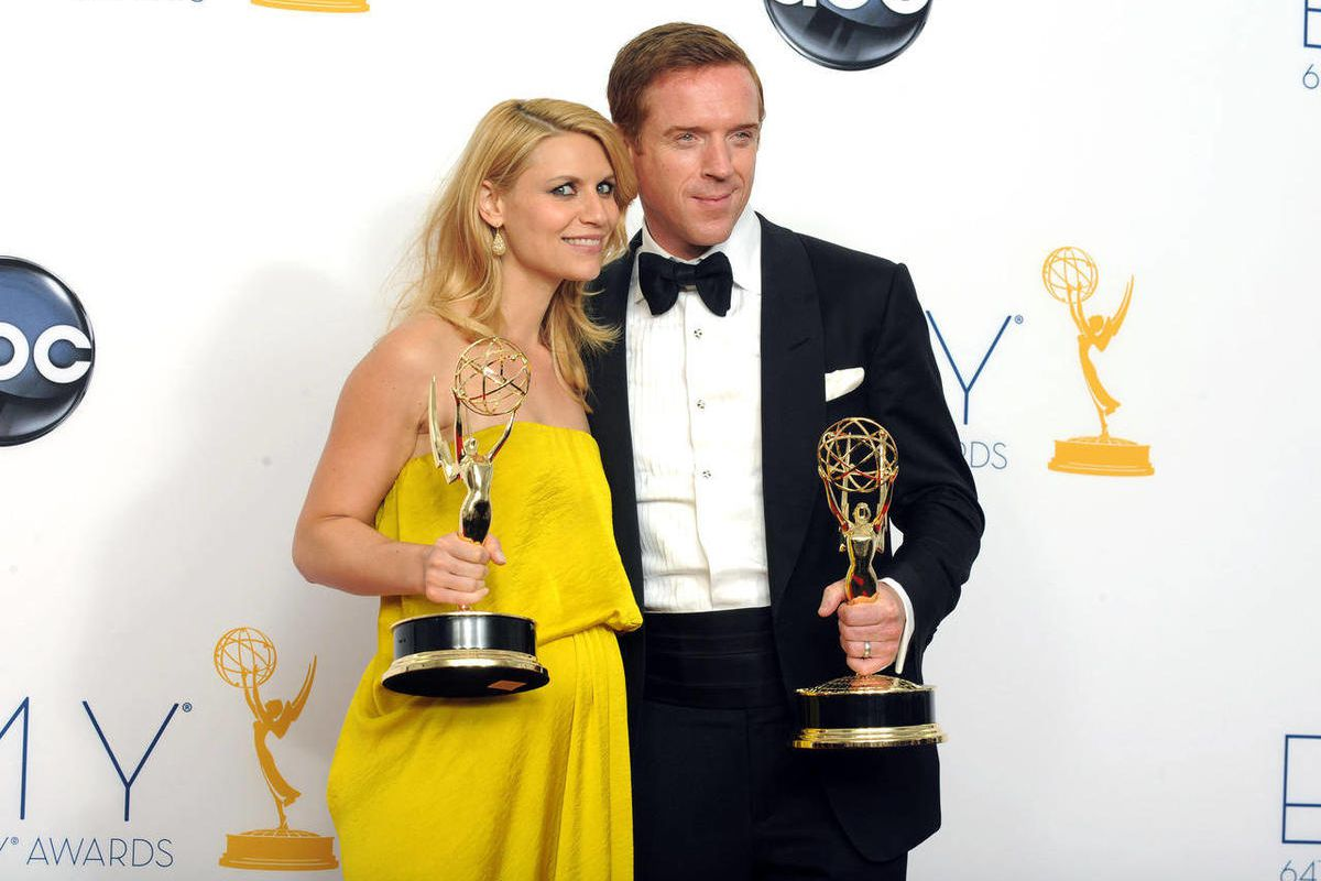 """Actress Claire Danes, winner of the Emmy for outstanding lead actress in a drama series for """"Homeland,"""" left, and actor Damien Lewis, winner of the Emmy for outstanding lead actor in a drama series for """"Homeland"""" pose together backstage at the 64th Primet"""