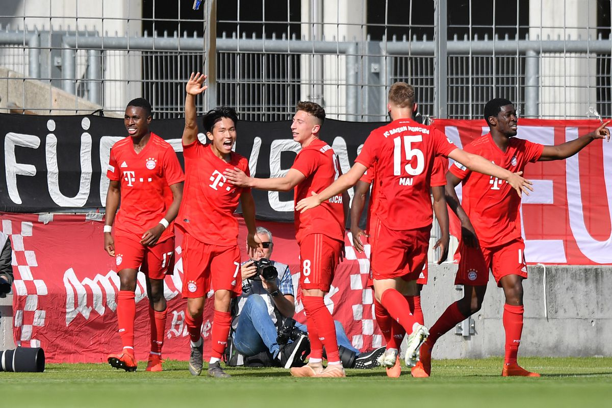 MUNICH, GERMANY - MAY 26: Players of Bayern Muenchen II celebrate after their team's fourth goal during the Third League Playoff Second Leg match between VfL Wolfsburg II and Bayern Muenchen II at Stadion an der Gruenwalder Straße on May 26, 2019 in Munich, Germany.