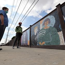 Artist Roger Whiting, of Community Arts of Utah, left, and project assistant Mati Simonds stand near their mosaic mural on 2700 West between 3500 South and 3100 South in West Valley City on Tuesday, March 16, 2021. Earlier, Gov. Spencer Cox and West Valley Mayor Ron Bigelow held a bilingual press event at West Valley City Hall to unveil the mural, dedicated to those who have taken their own lives, and a media campaign to raise awareness of mental health and suicide prevention resources available to Utah's Latino community.
