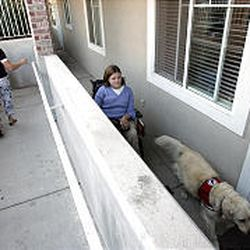 Sandy Nielson and Jamie Moore, with her dog Misty, walk back to Jamie's apartment after running some errands. Jamie and her mother have found that Utah's urbanized areas are far more handicapped-accessible than are rural parts of the state.