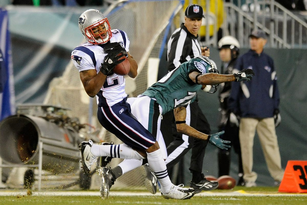 Antwaun Molden #27 of the New England Patriots intercepts a pass in front of DeSean Jackson #10 of the Philadelphia Eagles