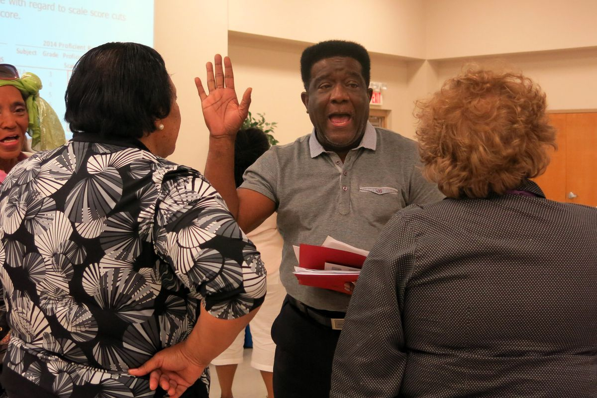 Outgoing MSCEA President Keith Williams talks with teachers in June after meeting with a state education official over confusing TCAP score results.
