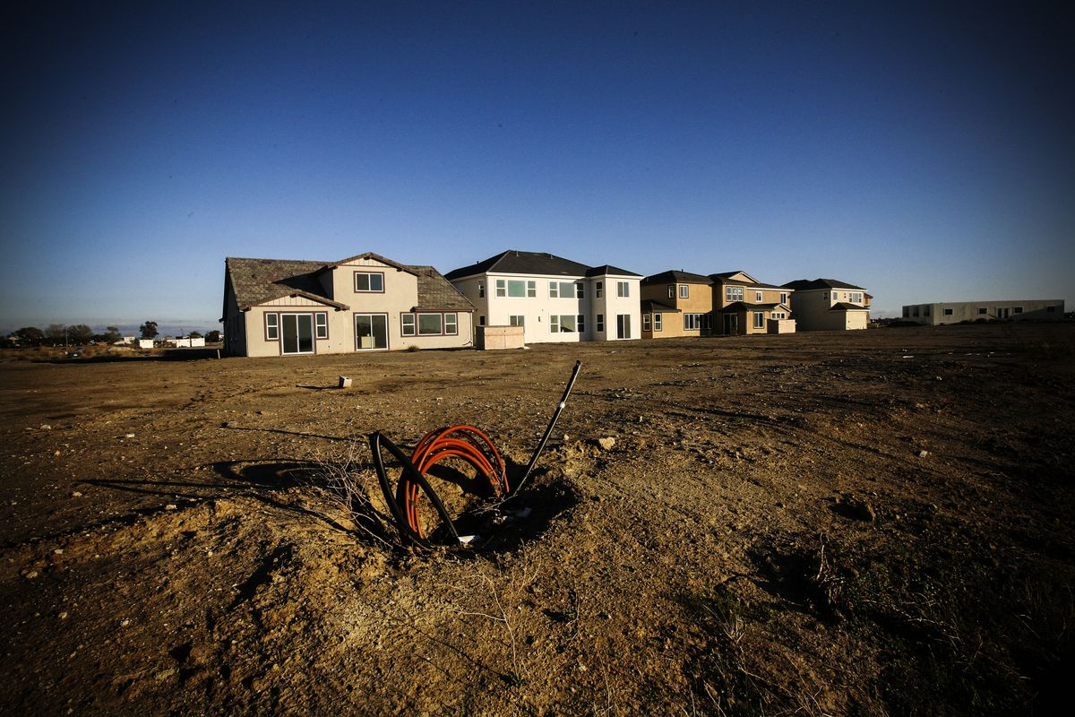 Model homes sit vacant at a 750-home housing development where construction was halted in Rio Vista, California, on November 20, 2008.